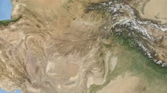 Night to day - rotating Earth. Zoom in on Afghanistan outlined Stock Footage
