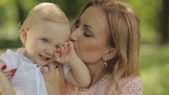 Mother Kissing Her Child - stock footage