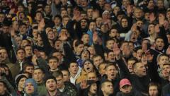 The fans chanting the chants at the stadium. People, crowd, football fans - stock footage