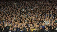 Football fans chanting the chants at the stadium. People, crowd, football fans - stock footage