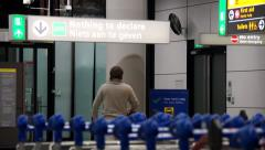 Airport nothing to declare sign man walking through the customs gate Stock Footage