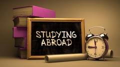 Stock Illustration of Hand Drawn Studying Abroad Concept on Chalkboard