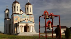 Christian monk ringing bells at the holy monastery of Codru in Dobrogea, Romania Stock Footage