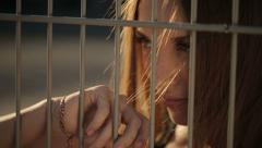 Beautiful Woman Behind Bars - stock footage