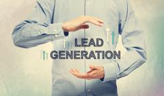 Young man in blue shirt holding Lead Generation - stock photo