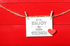 Enjoy the Little Things message with clothespins Stock Photos
