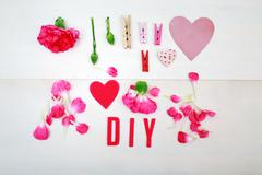 DIY text with clothespins and carnations Stock Photos