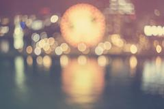 Defocused bokeh vintage colored night harbor lights background Stock Photos