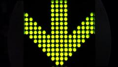Green LED light arrow pointing down and moving fast downwards - stock footage