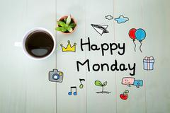 Happy Monday message with a cup of coffee - stock photo