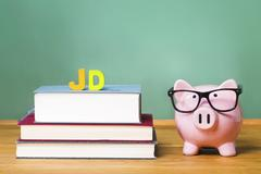 Juris Doctor law degree theme with pink piggy bank - stock photo