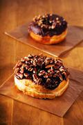 Chocolate pecan donuts Stock Photos