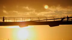 Early Morning sunrise over Millennium Bridge Stock Footage