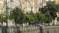 Rašínovo waterfront with trees and old buildings in Prague Stock Footage