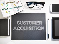 Customer Acquisition concept with black and white workstation - stock photo