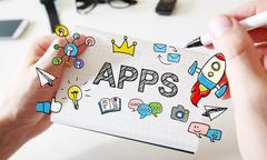 Mans hand drawing APPS concept on notebook Stock Photos