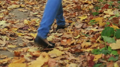 Woman walking cross country and trail in autumn forest Stock Footage