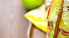 The camera moves and removes the infused apple water with cinnamon and anise. Stock Footage