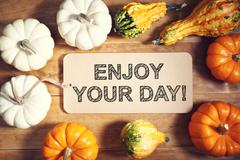 Enjoy Your Day message with colorful pumpkins Stock Photos