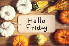 Hello Friday message with colorful pumpkins - stock photo