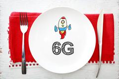 6G concept on white plate with fork and knife - stock photo