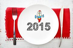 2015 concept on white plate with fork and knife - stock photo