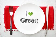 I love Green concept on white plate with fork and knife - stock photo
