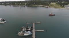 Aerial fishing boat leaves harbor 4k Stock Footage