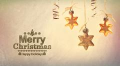 Merry Christmas message with hanging stars - stock photo
