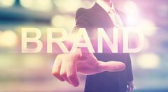 Businessman pointing at BRAND Stock Photos