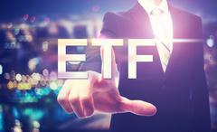 Businessman pointing at ETF Stock Photos