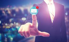 Businessman pointing at email icon Stock Photos
