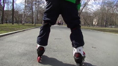 Child rollerblading views on skates Stock Footage