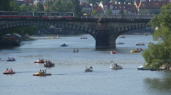Pedal boats floating near Legion Bridge in Prague Stock Footage