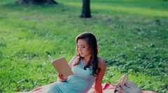 Young student reading a book Stock Footage