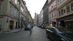 Tourists walking near the cars parked on Mostecka street, Prague Stock Footage