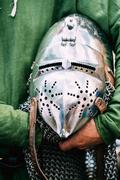 Knight Helmet Of Medieval Suit Of Armour On Table - stock photo