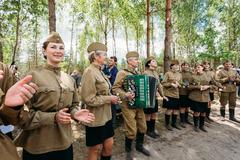 Artists dressed as Soviet Russian soldiers dance during events d Stock Photos