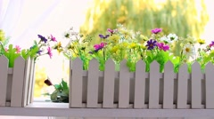 Exterior decoration. Plastic flowers in wooden white boxes Stock Footage