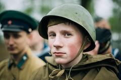 Unidentified re-enactor dressed as Soviet soldier during events - stock photo