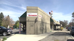 Stock Video Footage of Barber Shop Storefront & Cafe with a giant rooster on building