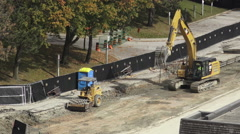 Excavator in a Construction Site Stock Footage