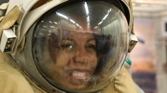 A woman pretends to be an astronaut during the exhibition of IAC 2015 Stock Footage