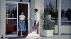 1959: Car saleman opening door for lady and child. Stock Footage