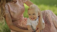 Mother Play and With Her Child In A Park On The Grass - stock footage