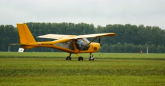 4K Stock Footage Two Yellow Light Aircrafts Taxiing Stock Footage
