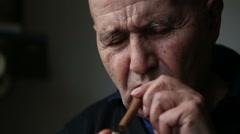 Old man smoking a cigar Stock Footage
