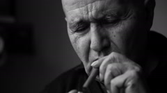 Old man smoking a cigar Stock Footage