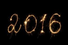 Happy New Year 2016. Inscription sparklers on dark background. Kuvituskuvat