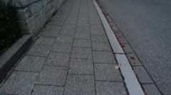 Fast movement the stone pavement. Stock Footage